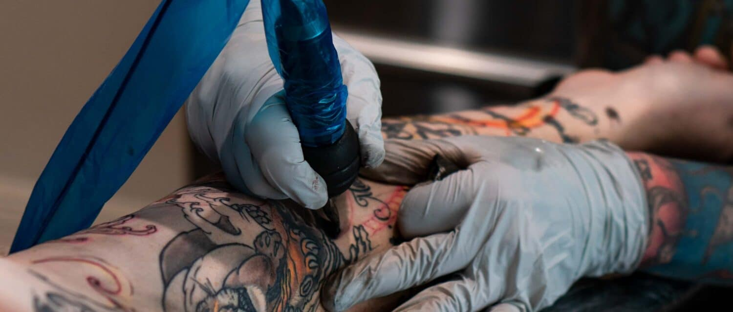 Tattoo artist tattooing arm | Sentient Tattoo Collective in Tempe, AZ