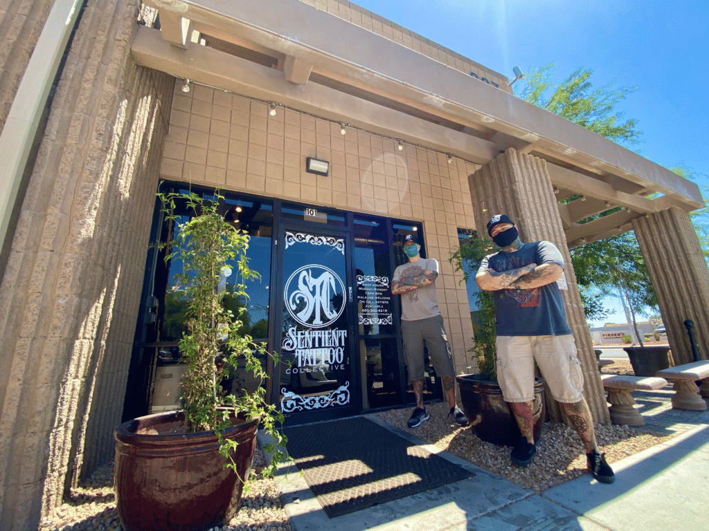 Owners Tyson Weed and Charles Tyson standing outside of tattoo shop in Tempe, AZ with face coverings.